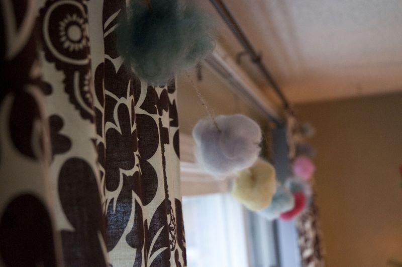 Pompom garland across window